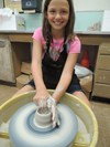 Working the pottery wheel